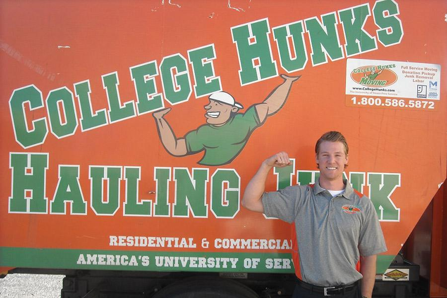 College+Hunks+Hauling+Junk+manager%2C+Mike+Neumayr%2C+loads+one+of+the+company%27s+signature+moving+vans.+