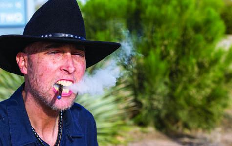 Michael Valle smokes a cigarette.