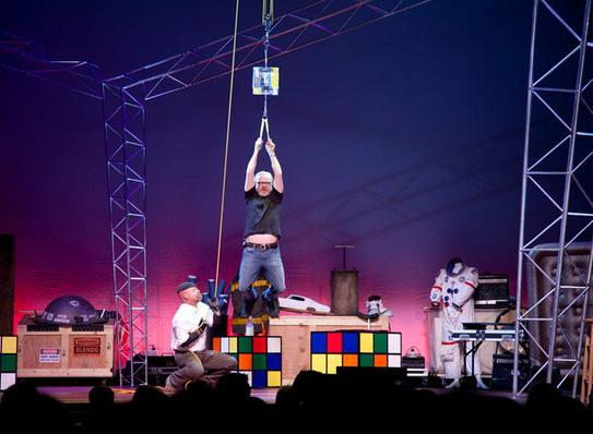 Adam Savage hangs from two ordinary interwoven phone books as Jamie Hyneman hoists him skyward. The experiment shows how strong the use of friction between objects is.