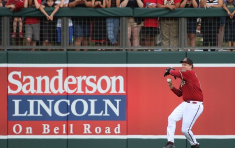 Will Ferrell prepares to make a throw from left field as fans look on.