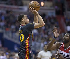 Golden State Warriors point guard Stephen Curry prepares to shoot the ball during a game against the Washington Wizards in Washington, D.C.