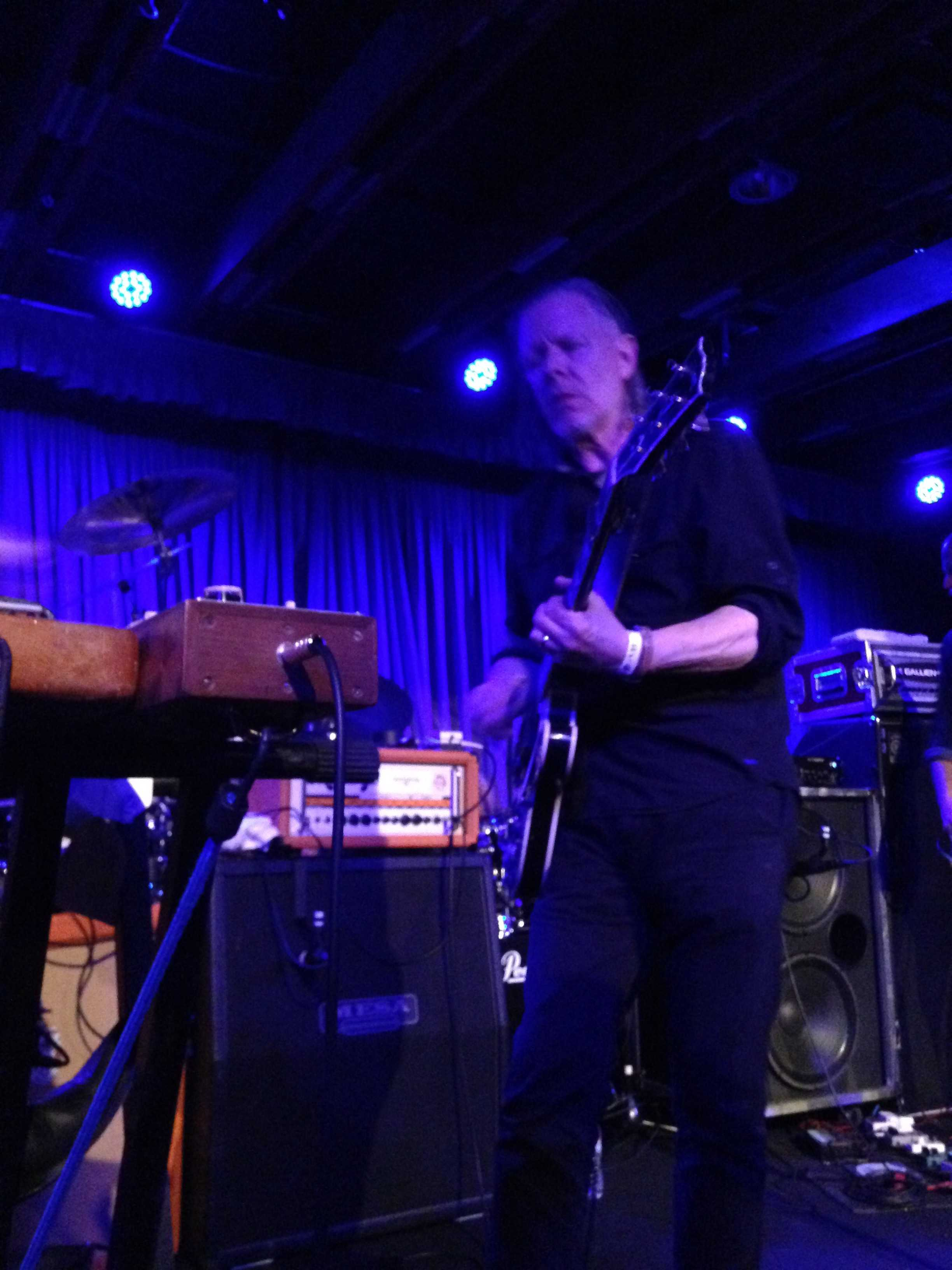 Guitarist and vocalist Michael Gira performs during Swans' April 13 concert at Phoenix's Crescent Ballroom.