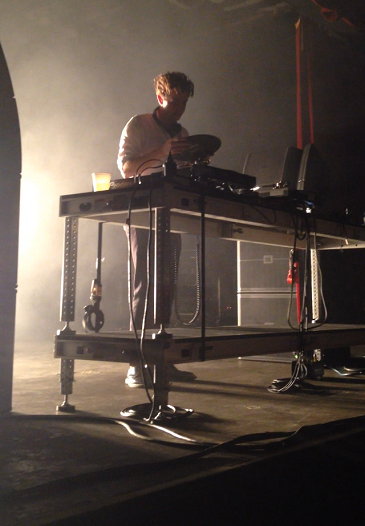 Jamie xx prepares to put a vinyl record on a turntable during his concert at Tempe's Marquee Theatre on Wednesday night.