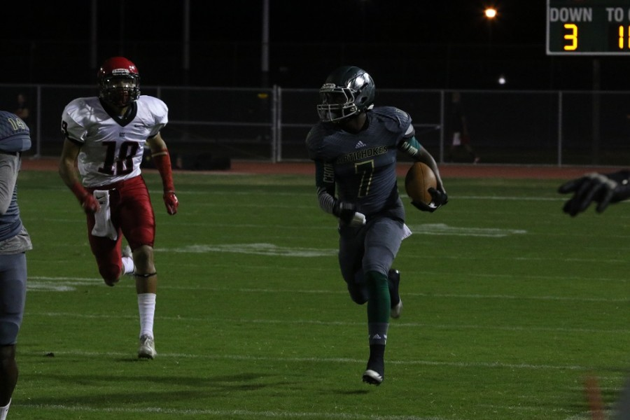 Artichokes cornerback Curtis Taylor runs with the ball towards the end zone after an interception. The Artichokes recorded four interceptions during their 35-27 win over Glendale.