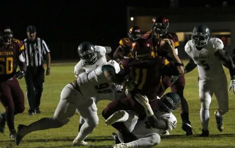 Defensive ends Kisima Jagne (44) and Iveni Ngauamo (90). sack Arizona Western quarterback Trenton Hosick (11) for a loss  during the Artichokes' 21-0 win in Yuma on Saturday night.