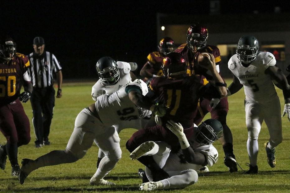 Defensive ends Kisima Jagne (44) and Iveni Ngauamo (90). sack Arizona Western quarterback Trenton Hosick (11) for a loss  during the Artichokes' 21-0 win in Yuma on Saturday night.