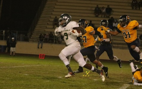 Artichoke wide reciever Shaquan Curenton catches a pass from quarterback Tyler Bruggman and runs for a touchdown during the Artichokes' 59-21 win over Phoenix College in the 2015 season.