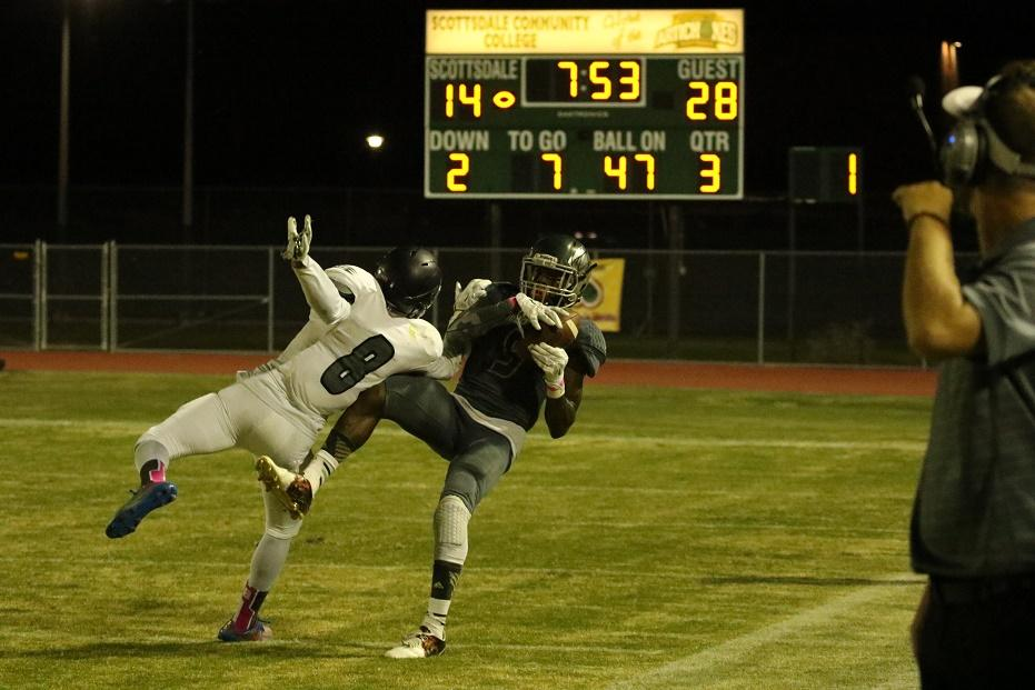 Artichoke wide receiver Shaquan Curenton (9) makes a catch down the field from quarterback Tyler Burggman. The Artichokes would settle for a field goal on this drive.