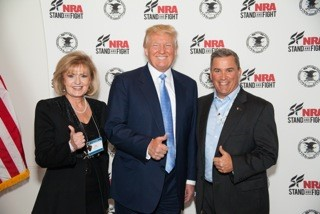 ) Lori Klein and Donald Trump alongside a colleague at the NRA Convention in Nashville, Tennessee.