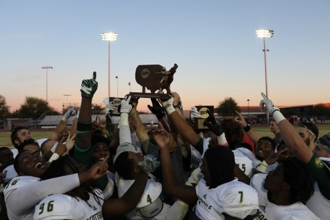 The victorious Artichokes hold up the Valley of the Sun Bowl trophy.