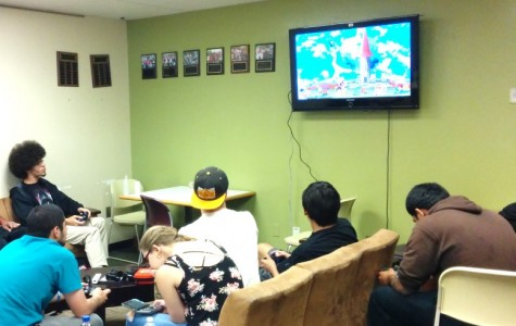 A group of SCC students relieve stress after classes by playing video games.