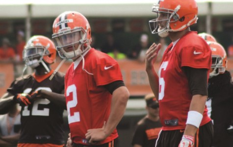 Johnny Manziel (center) looks on during a 2014 practice session with  the Cleveland Browns. The Browns released Manziel in March and he is as yet unsigned.