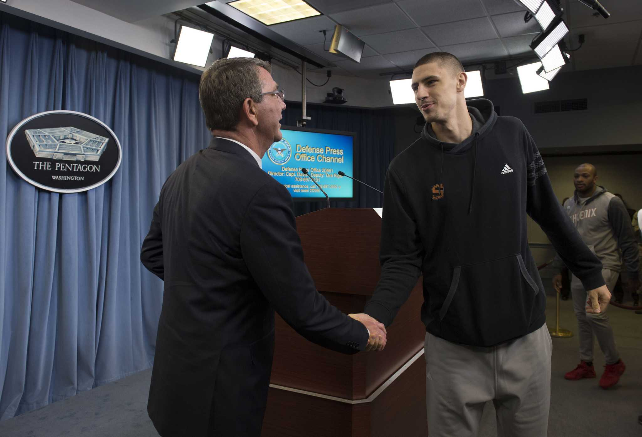 Secretary of Defense Ash Carter meets with Alex Len of the Phoenix Suns at the Pentagon, Dec 3, 2015.