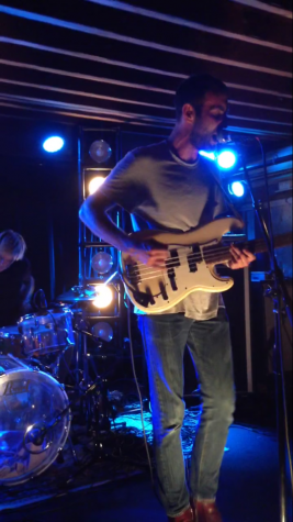 Preoccupations bassist and vocalist Matt Flegel performs