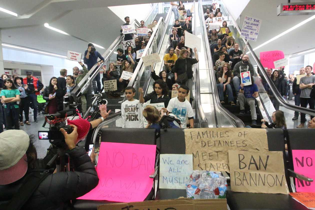 People sitting around escalators on the second day of protests at San Francisco International Airport after the recent Trump Immigration Ban
