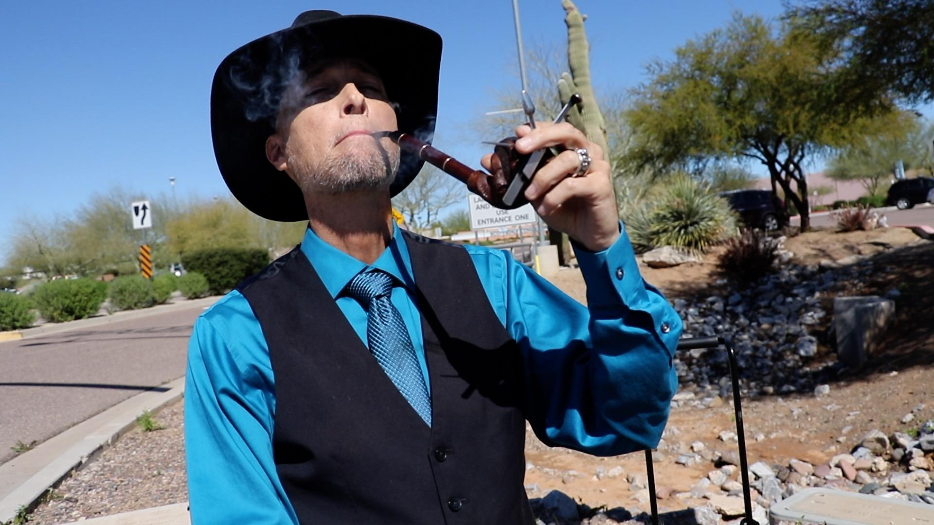 Dr. Michael Valle smoking his pipe off the campus at Scottsdale Community College