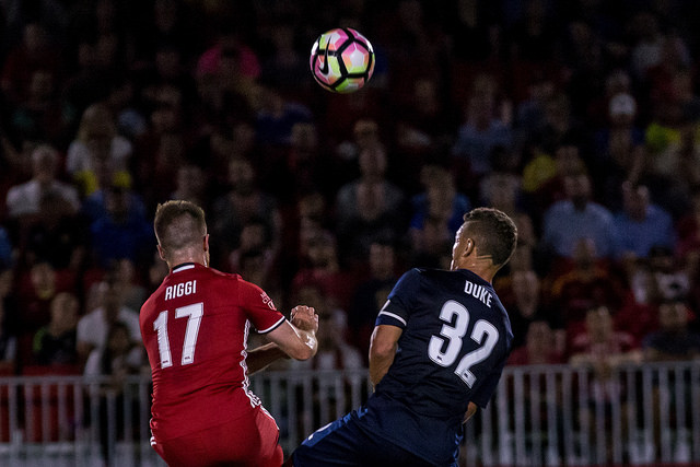 Phoenix Rising's Alessandro Riggi (in red) battles for the ball with Christian Duke of Swope Park Rangers (in blue) during Rising's 4-3 win at Phoenix Rising Soccer Complex on April 23.