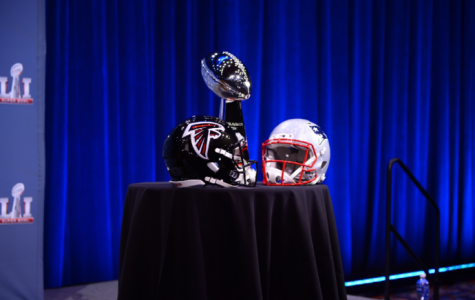 The New England Patriots (helmet pictured right) won the Vince Lombardi Trophy (middle) against the Atlanta Falcons (helmet pictured left) after a 25-point comeback and first-ever Super Bowl overtime session.