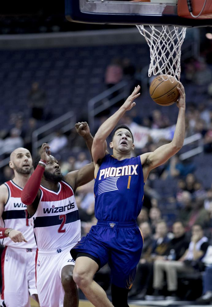 Phoenix Suns guard Devin Booker going up to score a lay-up