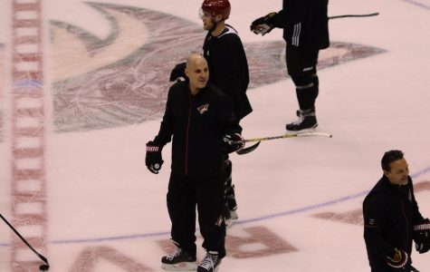 Arizona Coyotes head coach Rick Tocchet on the ice during practice.