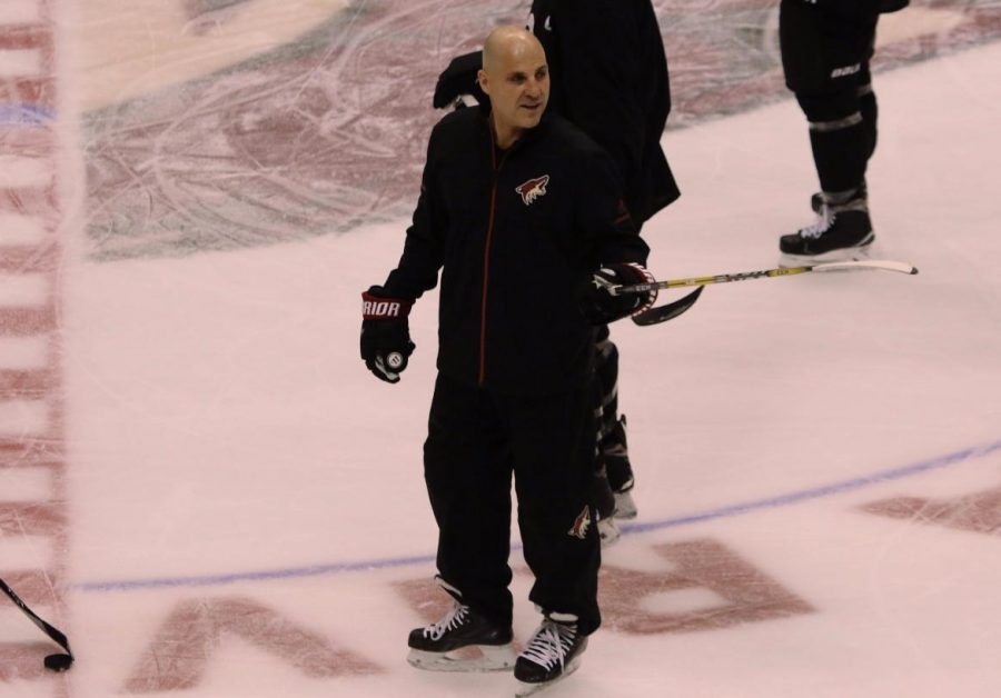 Rick Tocchet skating with the team during a practice session.
