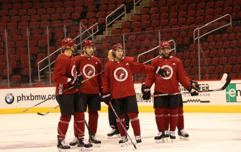 Coyotes players prepare to continue a drill during practice