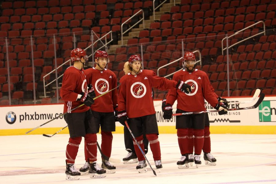 Coyotes+players+prepare+to+continue+a+drill+during+practice