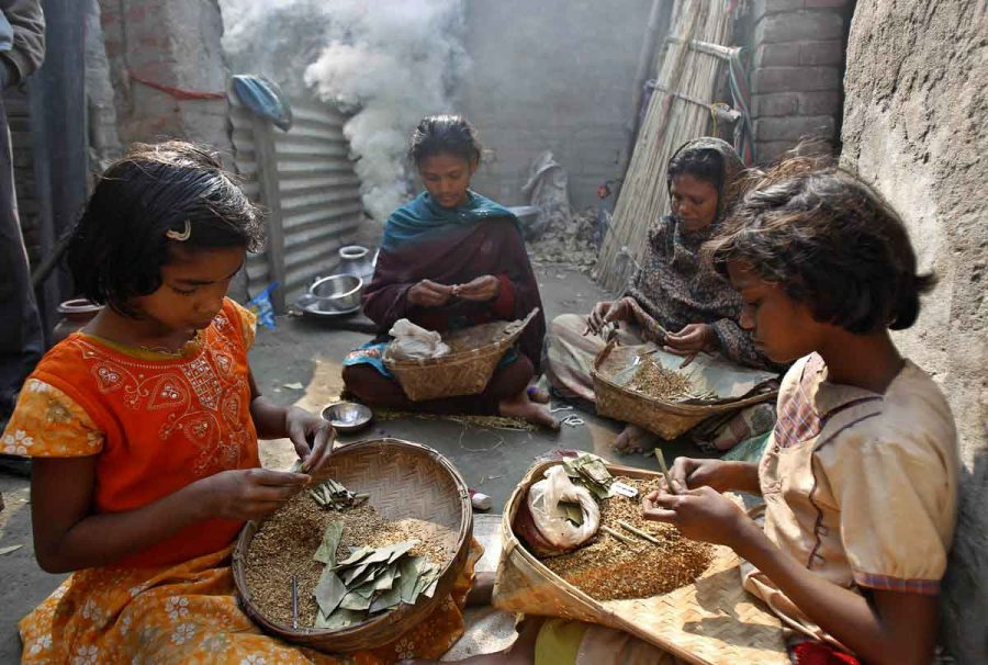 Instead of going school, these girls are doing work for their family involving tobacco in a small town in India called Lucknow.