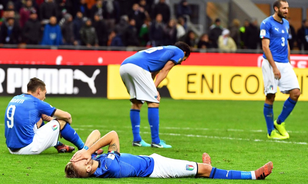 Players of Italy show their dejection after the FIFA World Cup 2018 qualification playoff, second leg soccer match between Italy and Sweden at the Giuseppe Meazza stadium in Milan, Italy, 13 November 2017. Sweden won 1-0 on aggregate.