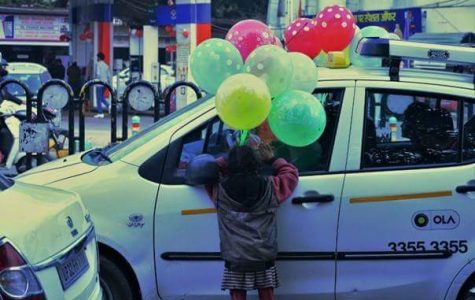 Hazratganj Market, Lucknow. Children under the age of 14 are selling balloons which is not legal, because according to law it's child labor.
