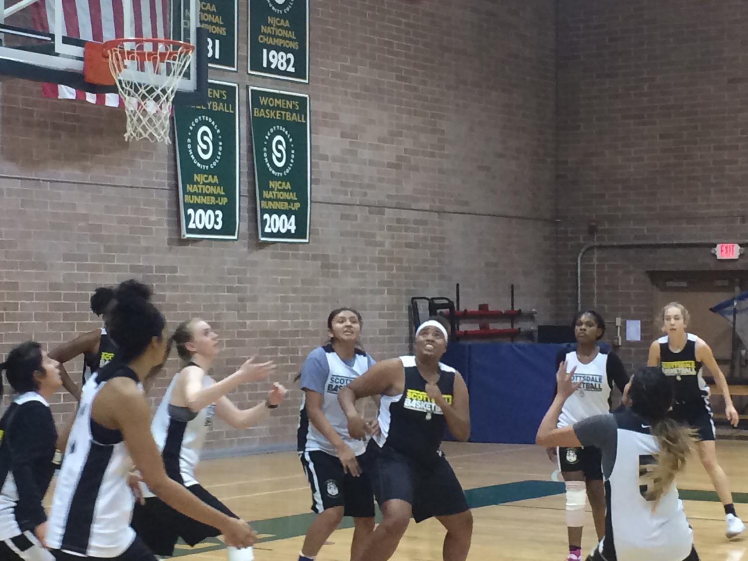 Artichoke players await a rebound during practice.