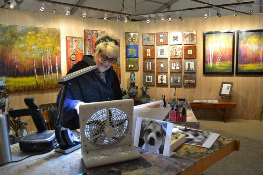 Mari Giddings working inside her studio during the annual Celebration of Fine Art in Scottsdale.