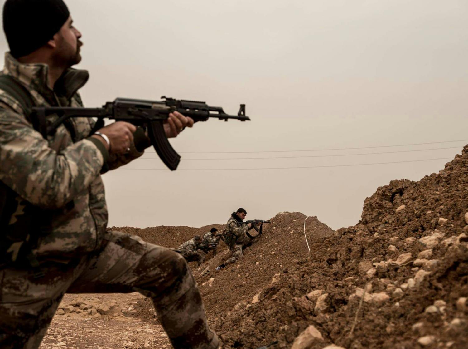 Kurdish YPG fighters in the frontline