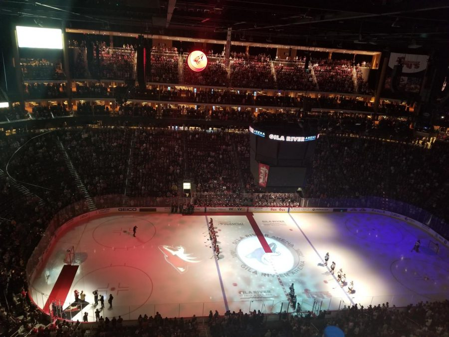 The Coyotes and the Ducks standing for the National Anthem