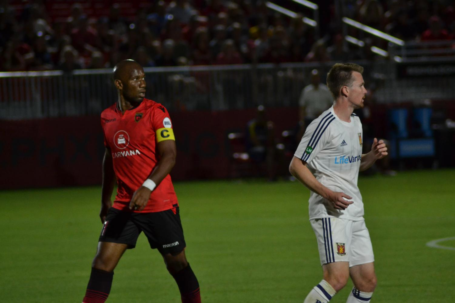 Didier Drogba carefully marked by Real Monarchs defender.