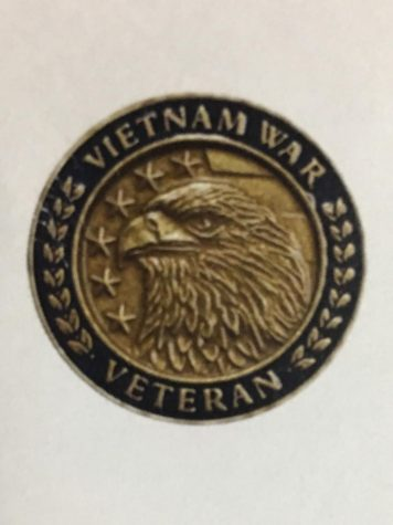 The commemoration pin that was given out to the veterans