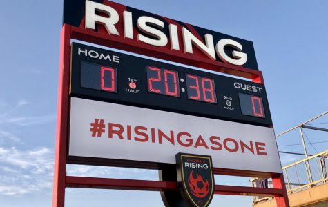 Rising scoreboard counts down until the start of the match