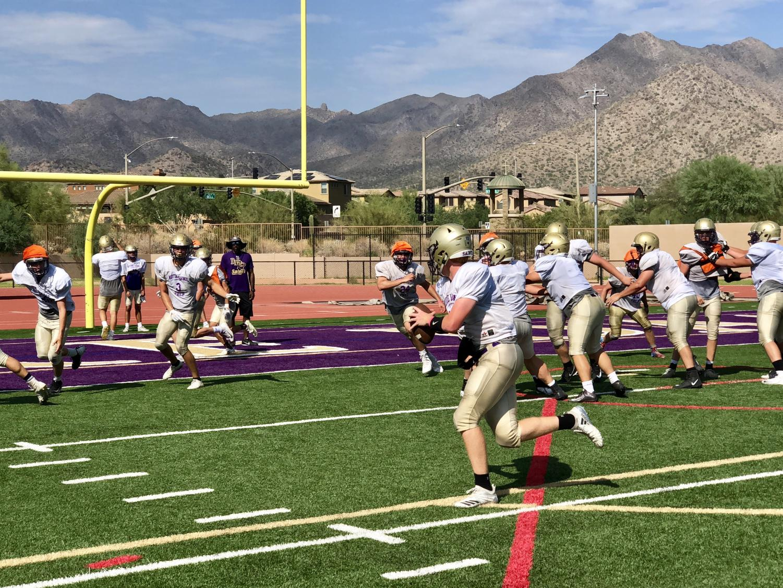 Senior quarterback, Jake Farrell, scrambles to his left