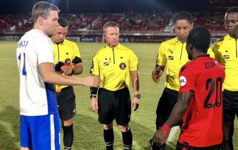 Rising captain, Solomon Asante, (right) during the coin toss