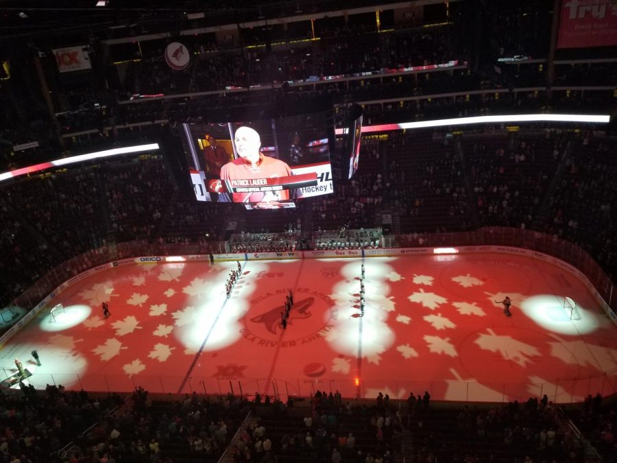 The+Coyotes+and+Canucks+wait+for+the+Canadian+National+Anthem+to+be+sung+by+official+anthem+singer+Patrick+Lauder.