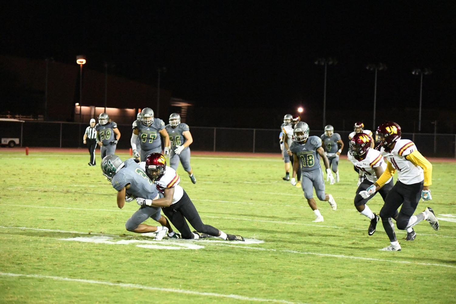 Scottsdale Artichokes Devin Neal with the ball before he is tackled by Arizona Western College