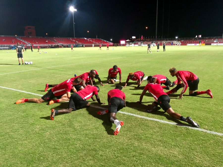 Rising starting 11 stretching before the game
