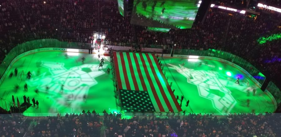 The Arizona Coyotes waiting the national anthem with the Boston Bruins on Military Appreciation night.