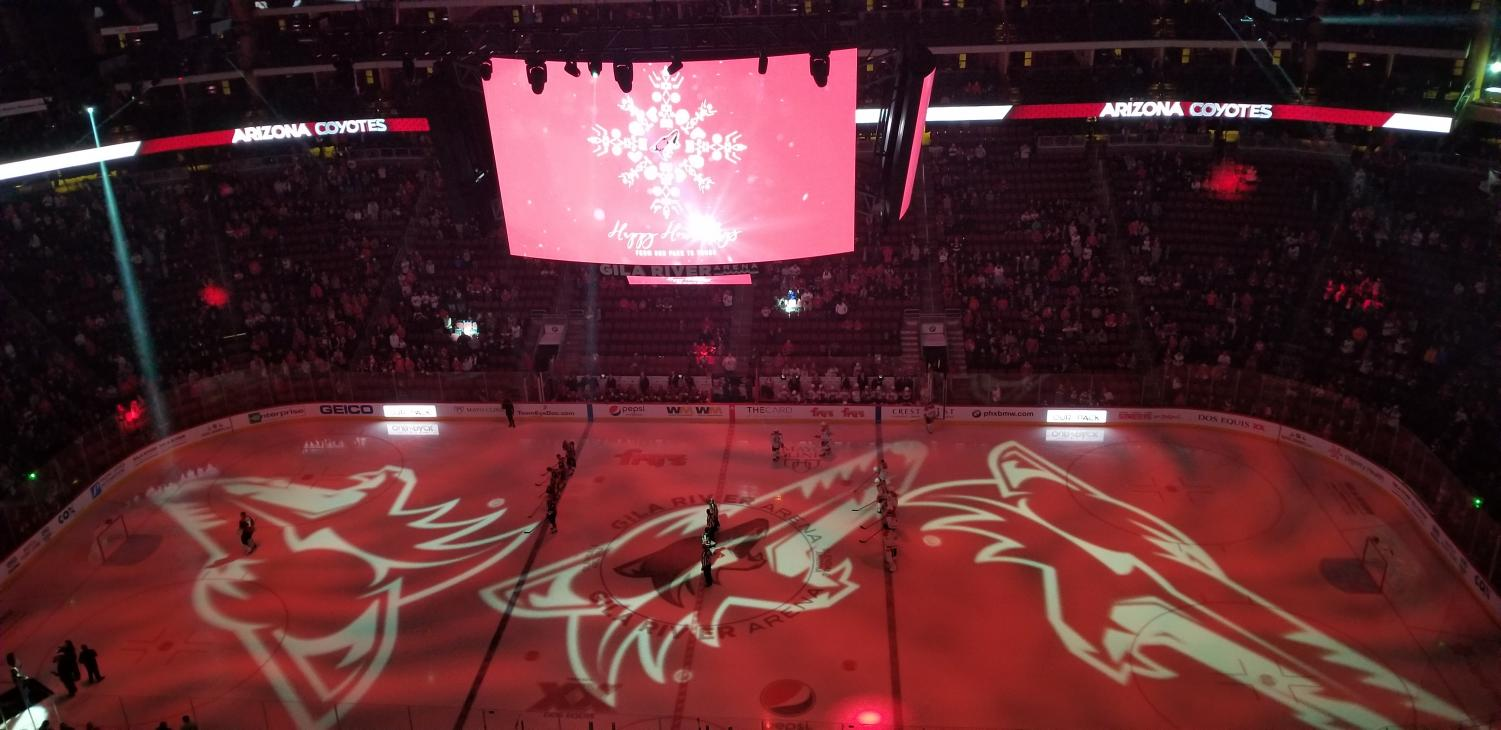 The Arizona Coyotes and Montreal Canadiens wait for the national anthems to be sung.