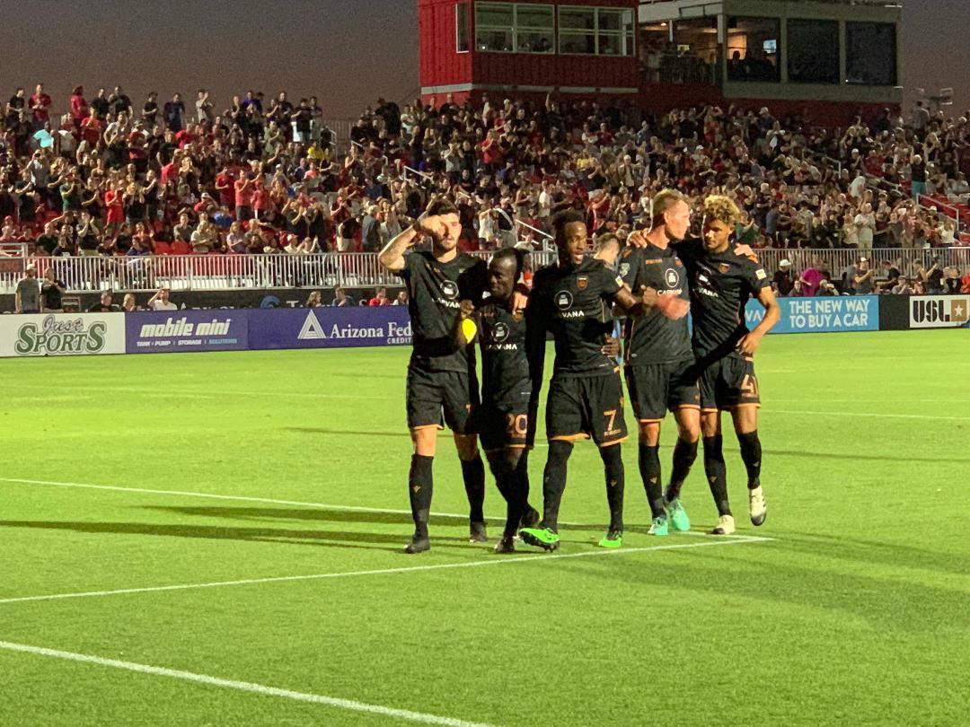 Solomon Asante with his teammates in Rising celebration