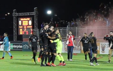 Phoenix Rising player celebrate following quarterfinal playoff win