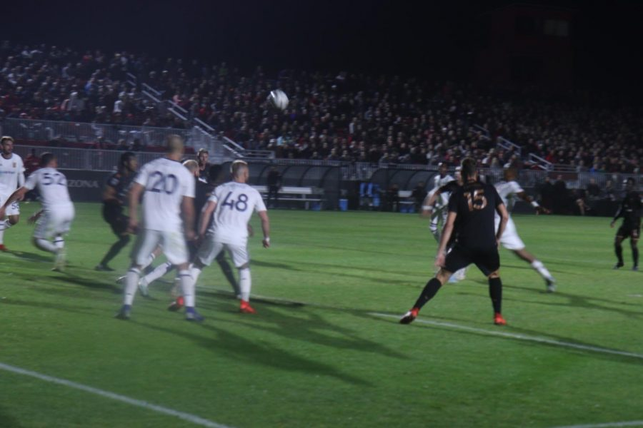 Salt Lake City players defend their goal Friday night.