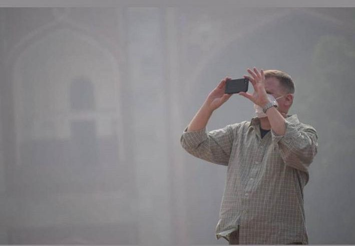 Taking a photo of pollution in Delhi