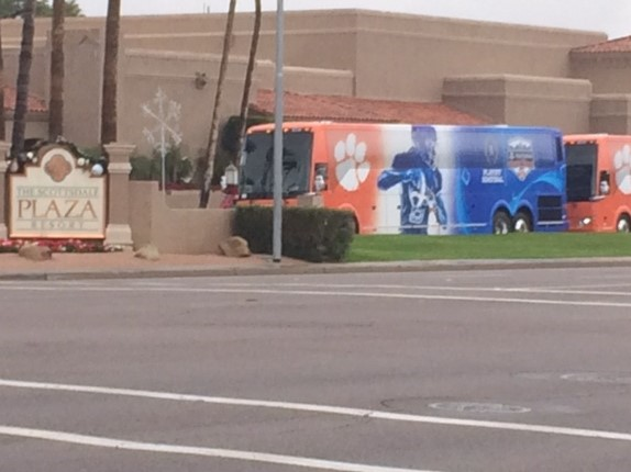 Clemson team busses lined up outside The Scottsdale Plaza Resort