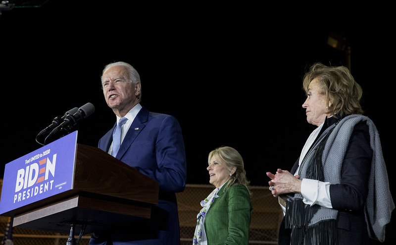 Former Vice President Joe Biden, flanked by his wife, Jill (green jacket), and sister Valerie Owens, speaks at a Super Tuesday rally in Baldwin Hills, California, on March 3, 2020.